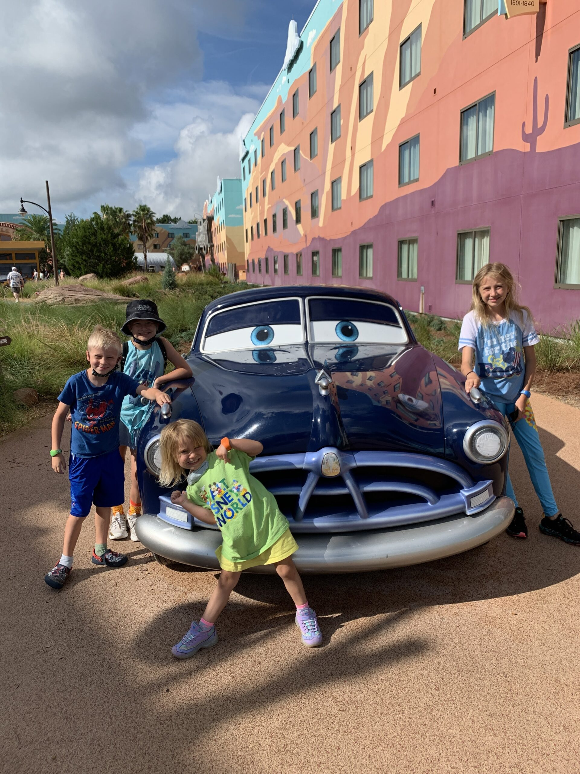 image of four kids with Doc Hudson of Cars