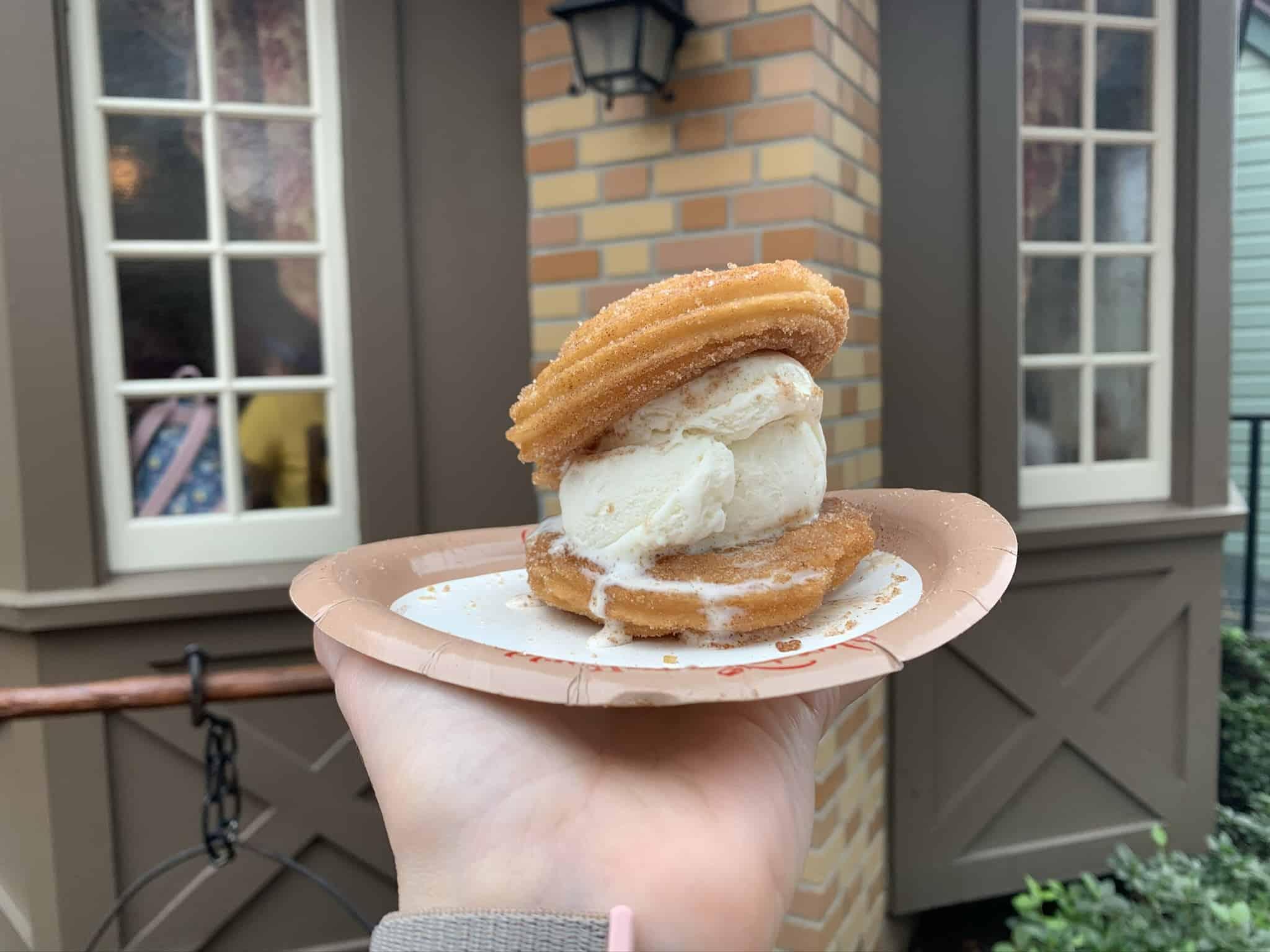 Disney churro ice cream sandwich on a paper plate