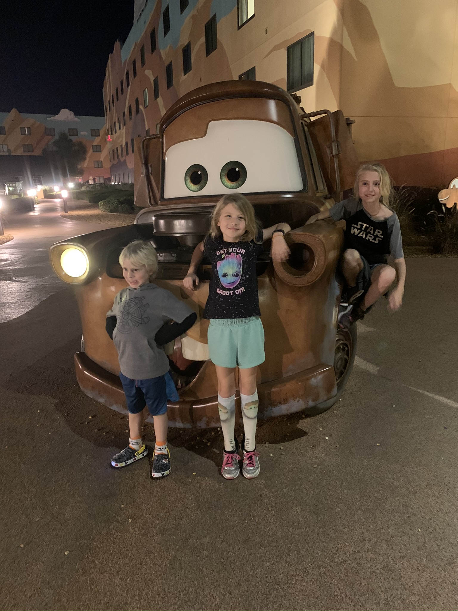 kids with Tow Mater of Cars at the Disney World Art of Animation Hotel